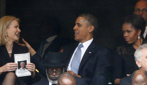 U.S. President Obama shares a moment with Denmark's PM Thorning-Schmidt during memorial service for Mandela in Johannesburg